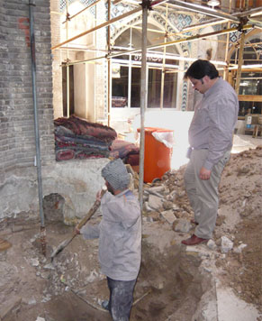 Photo of Alireza Sadeghian on the jobsite of a restoration project