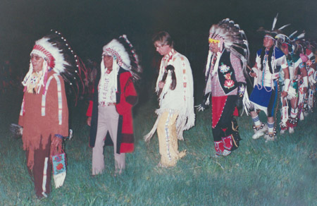 Grand Entry of the Whistling Waters clan at pow-wow